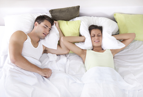 snoring in bed - sign of sleep apnea