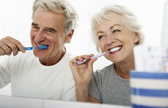 Baby boomer couple brushing teeth